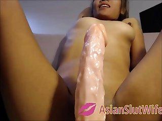 Asian Teen Sitting On A 12 Wiggle Dildo
