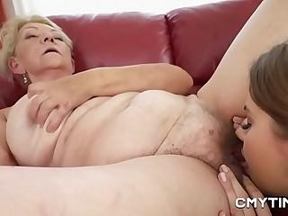 Teen cutie in bull dyke indecency with a GILF